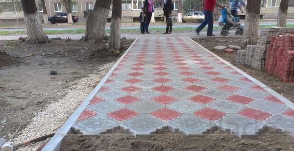 Укладка тротуарной плитки, бордюров.