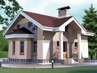 Двухэтажный дом из кирпича в стиле модерн с эркером и пилонами.